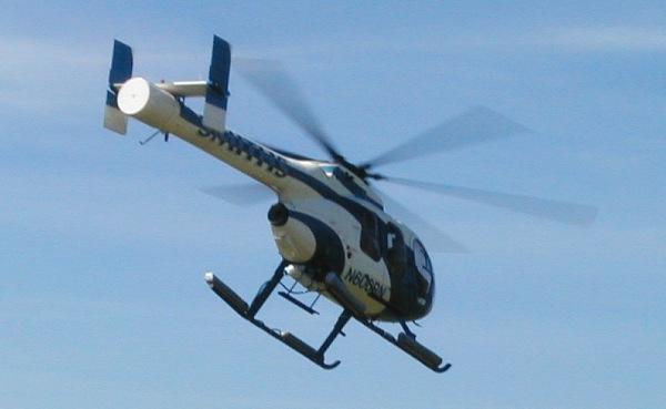 священник в вертолете